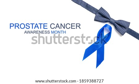 Blue ribbon. Awareness prostate cancer of men health in November. Blue ribbon, fashion bowtie isolated on white background. Symbol of oncology affected man. Copy space.