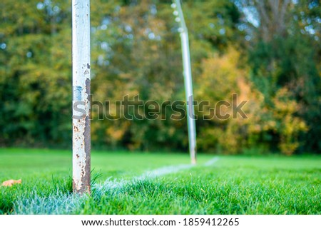 An old rusty abandoned football (soccer) goal on an english park symbolizing the death of grass roots sunday league football in the UK as a result of Covid-19 Coronavirus Royalty-Free Stock Photo #1859412265