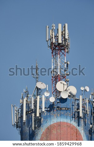 Signal transmitters for mobile network on a water tower Royalty-Free Stock Photo #1859429968