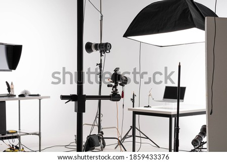 scene of Product photography session in professional photostudio Royalty-Free Stock Photo #1859433376