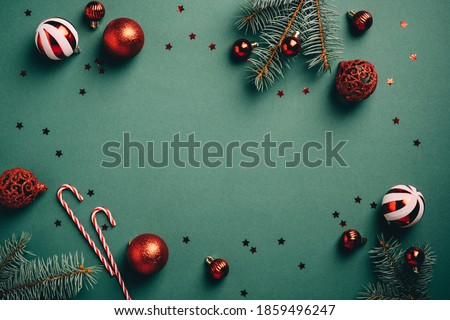 Vintage Christmas background with red and white balls decoration, fir tree branches, candy canes, confetti. Retro Christmas card template. #1859496247