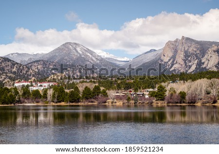 Mountain view with a lake. View of Estes park with the Stanley Hotel in view. Perspectiove from the other side of Estes Lake. #1859521234