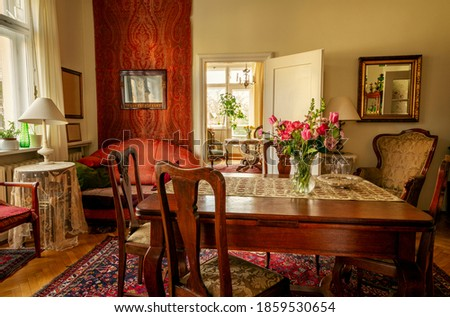 Old-fashioned sitting room with antique furniture Royalty-Free Stock Photo #1859530654