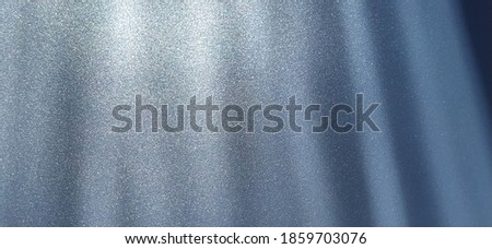 blurred striped dark black and blue background. Play of light and shadow. Light rays. Divine or heavenly radiance from above. Simulate lighting something from above with spotlights. Copy space Royalty-Free Stock Photo #1859703076