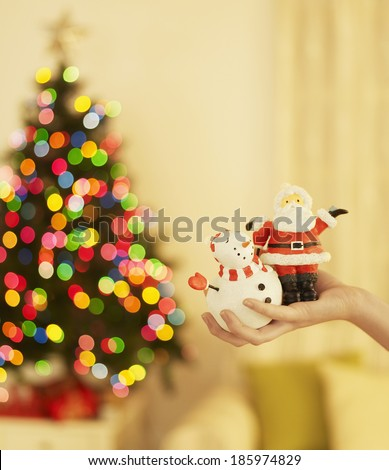 Woman's Hand Holding Christmas Decorations #185974829