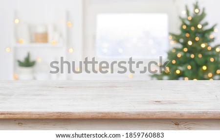 Table space in front of defocused window sill with christmas tree #1859760883
