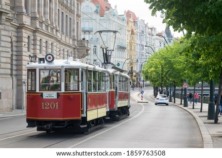 Historic tram on Prague street. Royalty-Free Stock Photo #1859763508