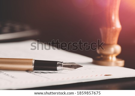 Law, notary background theme. Fountain pen and handmade paper on desk Royalty-Free Stock Photo #1859857675