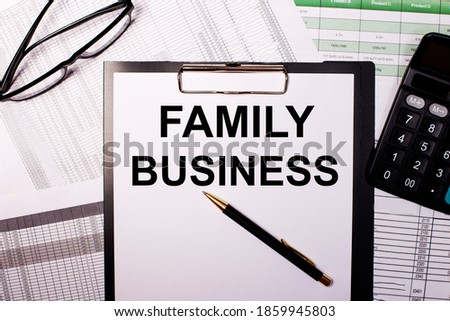 FAMILY BUSINESS is written on a white sheet of paper, near the glasses and the calculator.