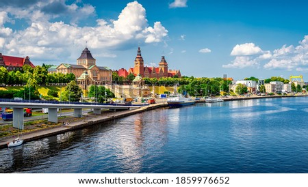 Aerial view of Chrobry Shafts, called Waly Chrobrego, moored ships and castle like buildings of National Museum and Passport Office, Szczecin, Poland Royalty-Free Stock Photo #1859976652