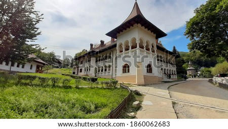 View of a Brancovenesc style palace build with balcony and windows with circular arches. Building in Romanian Renaissance style. #1860062683
