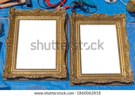 Two Empty Gold Picture Frames at Tarp Flea Market