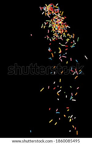 Sugar sprinkle dots on a black background Royalty-Free Stock Photo #1860085495