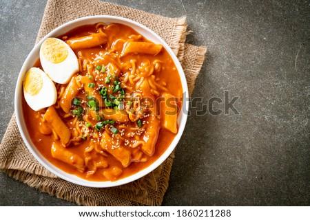 Korean instant noodle and Tteokbokki in Korean spicy sauce, Rabokki - Korean food style Royalty-Free Stock Photo #1860211288