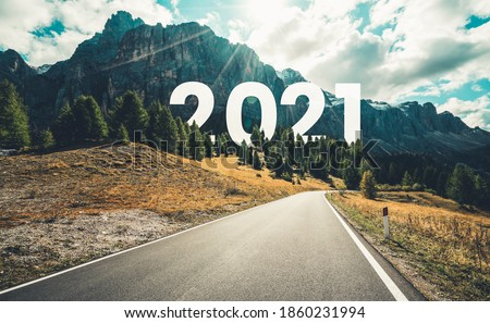 2021 New Year road trip travel and future vision concept . Nature landscape with highway road leading forward to happy new year celebration in the beginning of 2021 for fresh and successful start . #1860231994