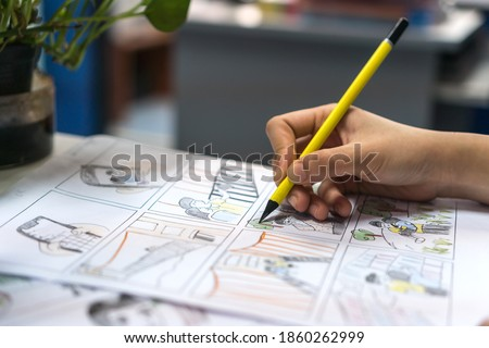 Animator designer create Storyboard color drawing creative for movie process pre-production media films script for video, creating graphic characters cartoon for music vdo clips production in studio