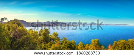Cannes and La Napoule panoramic sea bay view, yachts and boats from Theoule sur Mer. French Riviera, Azure Coast or Cote d Azur, Provence, France Royalty-Free Stock Photo #1860288730