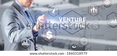 Businessman touching finger Venture Capital. Mixed Media. Royalty-Free Stock Photo #1860318979