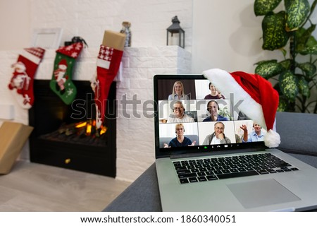 Christmas day Virtual meeting team teleworking. Family video call remote conference. Laptop webcam screen view. Diverse portrait headshots meet working from their home offices. Happy hour party online Royalty-Free Stock Photo #1860340051