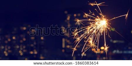 New Year's celebration sparkler at night Royalty-Free Stock Photo #1860383614