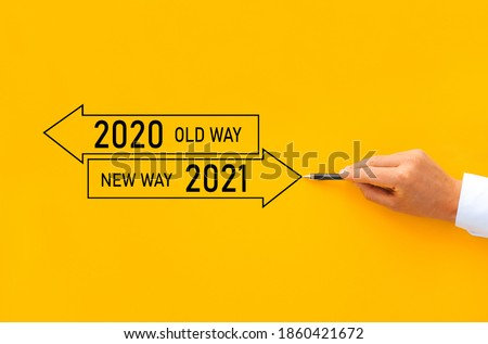 Businessman drawing arrow panel with Old way 2020 and New way of the  year 2021. Improvement and change management. #1860421672