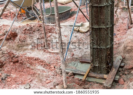 Column formwork Internal steel structure Made up of poles from the ground. Column timber form work and reinforcement bar at the construction site. Construction of reinforcement concrete of column.  #1860551935