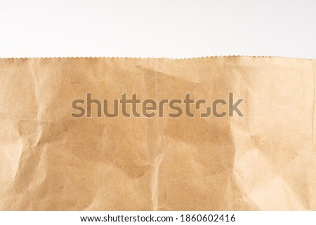 Craft paper. Crumpled brown cardboard paper texture. Old Crumpled recycled paper texture, color beige. Brown background Royalty-Free Stock Photo #1860602416