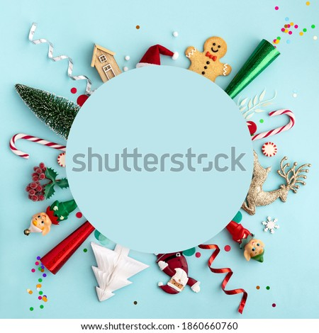 Christmas ornament flat lay background on blue, overhead view Royalty-Free Stock Photo #1860660760