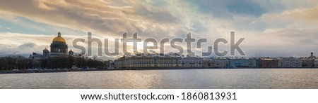 Saint Petersburg, Russia - a panoramic landscape from the embankment of the Neva river, a view from the university embankment to the English embankment and Kazan Cathedral. Royalty-Free Stock Photo #1860813931