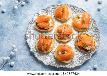 Blini with smoked salmon and sour cream, garnished with dill Royalty-Free Stock Photo #1860827434