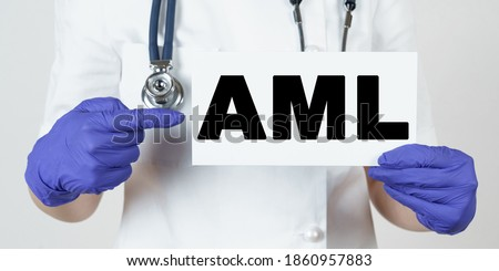 Medicine and health concept. The doctor points his finger at a sign that says - AML. Acute Myeloid Leukemia Royalty-Free Stock Photo #1860957883