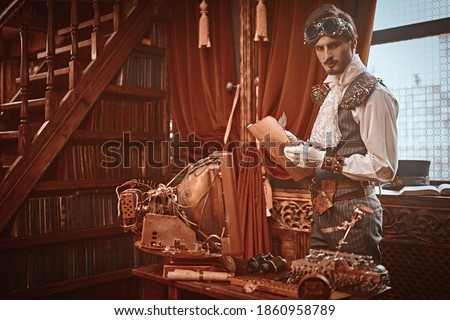 Scientist steampunk man inventor works in his laboratory with Victorian interior. Adventure world of steampunk. Royalty-Free Stock Photo #1860958789