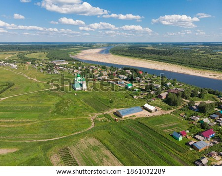 Church of Dmitry Solunsky and the village of Lomonosovo. Russia, Arkhangelsk region, Kholmogorsky district #1861032289