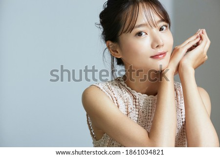 Natural beauty portrait of young Asian woman Royalty-Free Stock Photo #1861034821