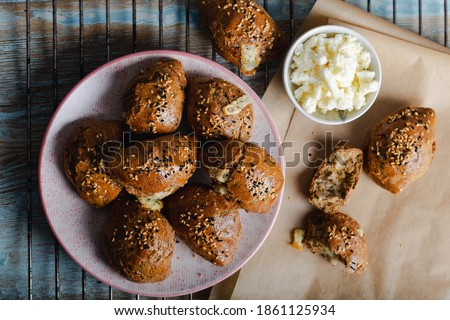 Homemade Pastries with Sesame Seeds.  Turkish pogaca (pastry) made with einkorn flour. #1861125934