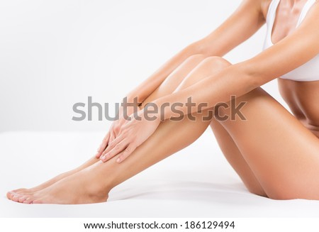 Body care of female Smooth legs. Royalty-Free Stock Photo #186129494