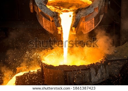 Tank pours liquid metal at the steel mill Royalty-Free Stock Photo #1861387423
