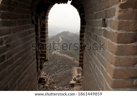 Non-restored part of the Great Wall of China. Picture taken from inside an abandoned and old watch tower on top of the great  wall.