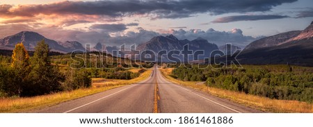Beautiful View of Scenic Highway with American Rocky Mountain Landscape in the background. Colorful Summer Sunrise Sky. Taken in St Mary, Montana, United States. Royalty-Free Stock Photo #1861461886