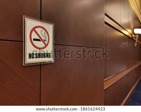 No smoking sign on wooden wall. Perspective image.