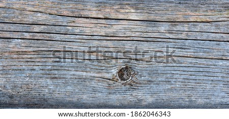 Pale faded brown and cool blue reclaimed pine wood surface with aged boards lined up. Weathered wooden planks on a wall or floor texture. Neutral stained vintage wood background. Royalty-Free Stock Photo #1862046343