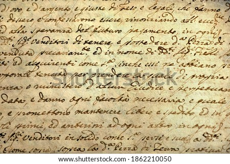 Ancient manuscript of 1700 century written in ink and goose pen in Italian. Antique letter with handwritten text. Stained texture background. Vintage style toned picture