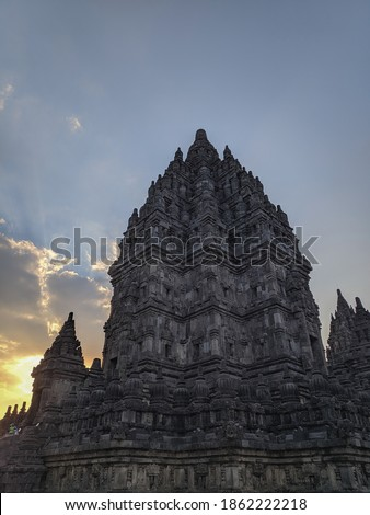 Prambanan hindu temple at sunset time, sun behind the building's silhouette, mountain temple made of stone. No people in the picture. UNESCO World Heritage Site. Yogyakarta, Java, Indonesia, Asia