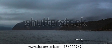 Overcast morning on the rocks between Umina Beach and Pearl Beach on the NSW Central Coast Royalty-Free Stock Photo #1862229694