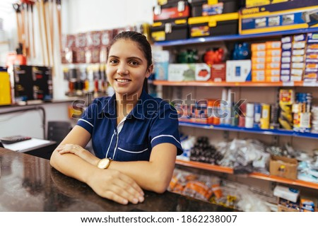 Young latin woman working in hardware store Royalty-Free Stock Photo #1862238007