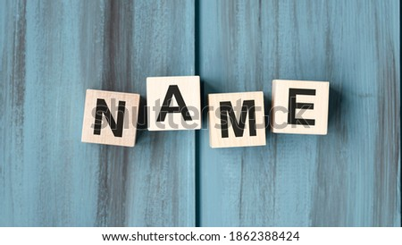NAME word written on wood block. NAME text on wooden table for your desing, concept. Royalty-Free Stock Photo #1862388424