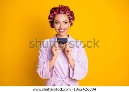 Photo of girl hold credit card easy pay income earnings savings wear bath robe isolated yellow color background