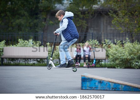 The guy in the jump on the kick scooter Royalty-Free Stock Photo #1862570017