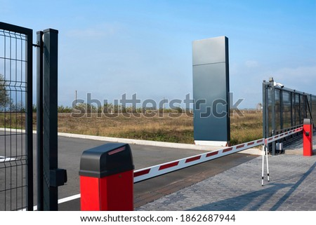 Closed automatic gate of the barrier. Automatic security system for private areas. Automatic entry system, parking barrier. Royalty-Free Stock Photo #1862687944