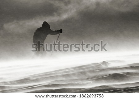 against the wind, on a ski expedition in a blizzard Royalty-Free Stock Photo #1862693758
